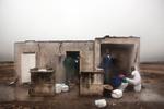 Michele Palazzi & Alessandro Penso: Migrants Repairing from the Rain, Basilicata, Italy