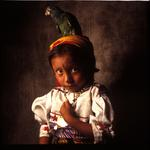 William Coupon: Cuna Parrot Girl, Porvenir, San Blas Islands, Panama, 1992